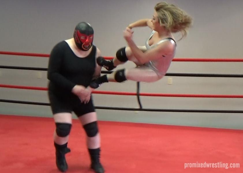 Toro taken down by Madi's dropkick