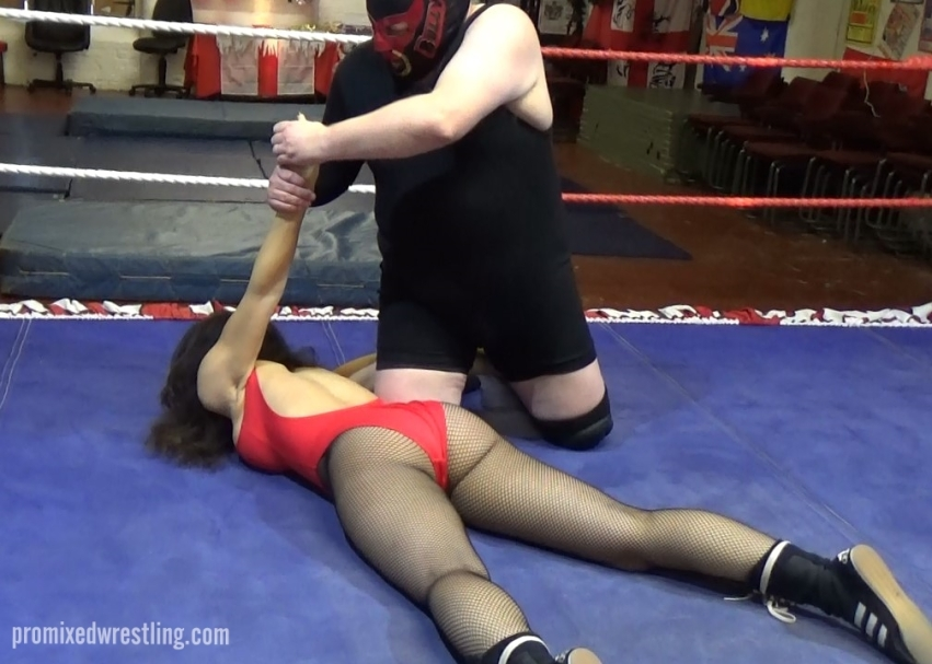 The Bully applies an agonising armbar crucifix to Laken
